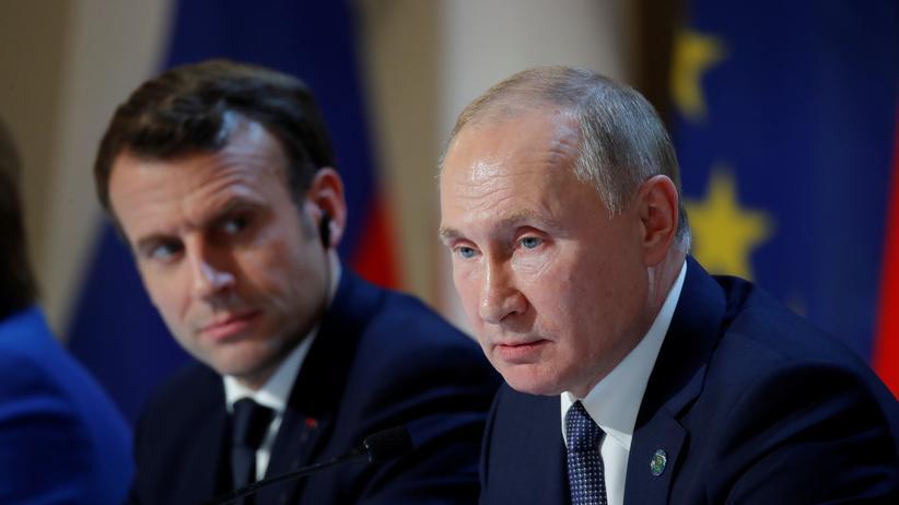 Ostukraine: Emmanuel Macron und Wladimir Putin auf der Pressekonferenz nach dem Gipfeltreffen in Paris