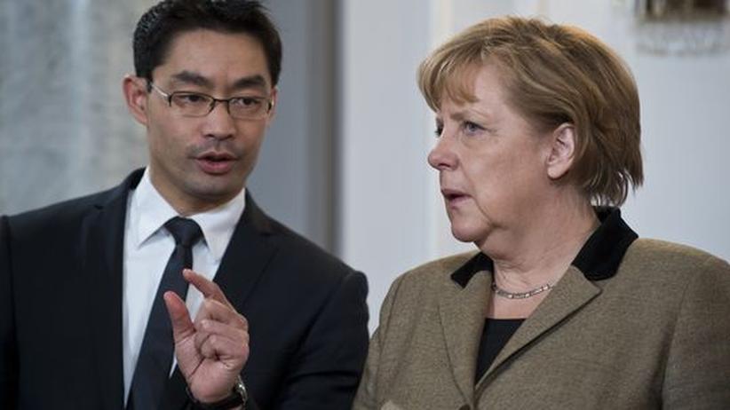 Philipp Rösler im Gespräch mit Angela Merkel