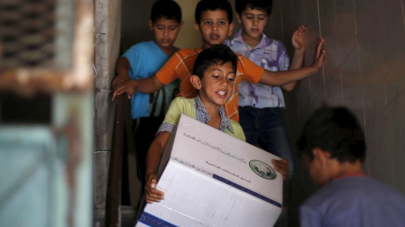 Flüchtlinge: Flüchtlinge in Jordanien erhalten Lebensmittelhilfen.