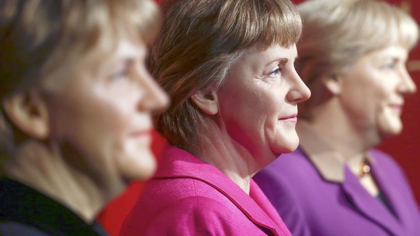 Flüchtlingspolitik: Angela Merkel in Wachs - drei Figuren aus drei Legislaturperioden im Madame Tussauds.