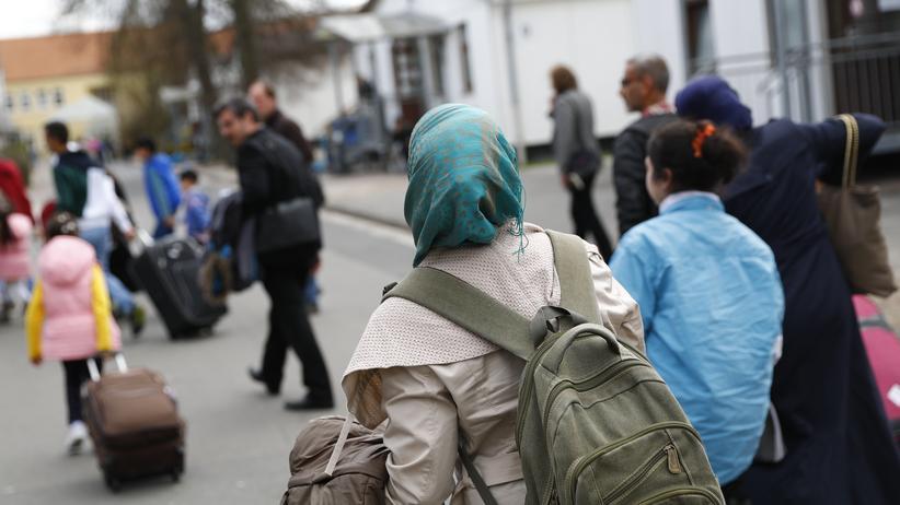 Flüchtlingskrise: Flüchtlinge aus Syrien erreichen eine Unterkunft in Deutschland.