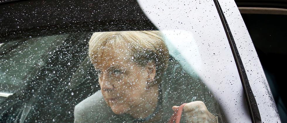 Angela Merkel am Sonntagmorgen vor der letzten Sondierungsrunde: Ausländische Medien interpretieren das Scheitern als ihren Machtverlust.