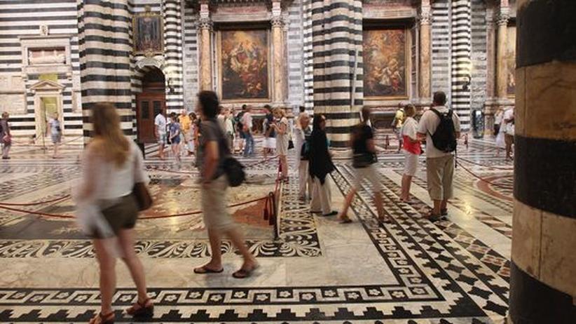 Kirchenbesuche: Gott macht keinen Urlaub