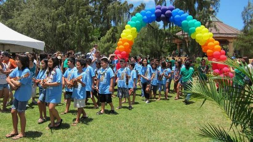 Einmal im Jahr wird im Kapiolani Park in Honolulu das Ukulele Festival gefeiert.