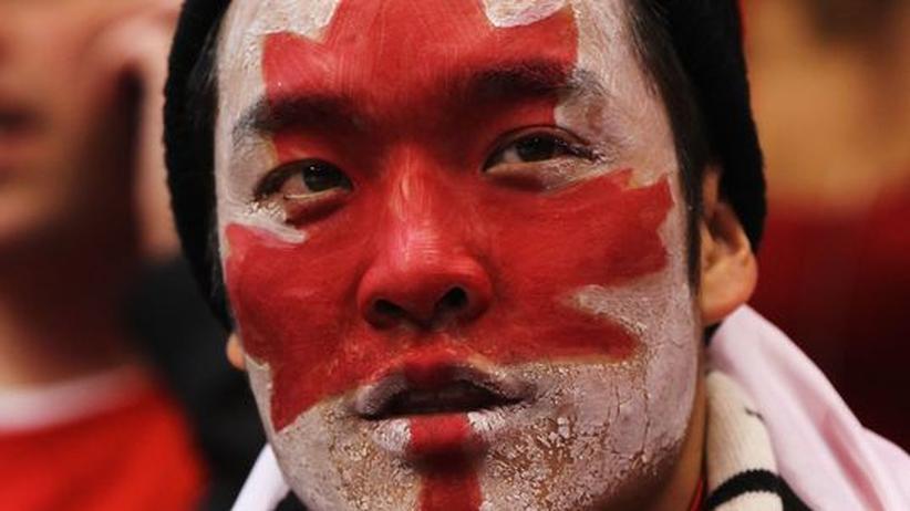 In den Farben seines Landes: Ein Fan des kanadischen Eishockeyteams während des Spiels gegen die Schweiz