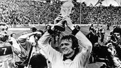1974: German goalkeeper Sepp Maier holds the World Cup Trophy aloft, after West Germany's 2-1 victory over Holland in the 1974 World Cup Final at the Olympic Stadium in Munich. (Photo by Keystone/Getty Images)