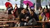 People react after a goal as they watch the 2010 World Cup soccer match between Germany and Australia during a public viewing event in a Munich beer garden 'Hirschgarten' June 13, 2010.   REUTERS/Michaela Rehle (GERMANY - Tags: SPORT SOCCER WORLD CUP)