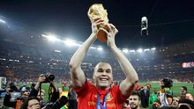 01-RTR2GBY9 Spain's Andres Iniesta holds the World Cup trophy after the 2010 World Cup final soccer match between Netherlands and Spain at Soccer City stadium in Johannesburg July 11, 2010.            REUTERS/Kai Pfaffenbach (SOUTH AFRICA  - Tags: SPORT SOCCER WORLD CUP IMAGE OF THE DAY TOP PICTURE)
