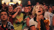 "Fans of the German national football team react during the public viewing at the ""Fanmeile"" (Fan Mile) in Berlin on July 7, 2010, of the FIFA World Cup semi-final match Germany vs Spain in Durban, South Africa. Spain won 1-0.   AFP PHOTO / JOHANNES EISELE (Photo credit should read JOHANNES EISELE/AFP/Getty Images)"