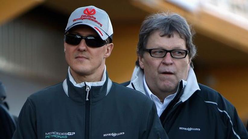 Die Mercedes-Mitarbeiter Michael Schumacher und Norbert Haug