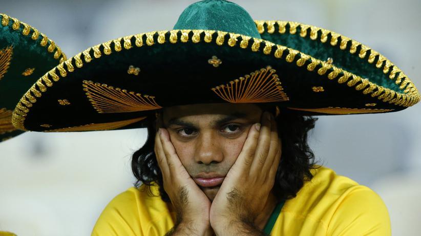 WM 2014: Ein brasilianischer Fan demonstriert die neue Zurückhaltung des Landes.