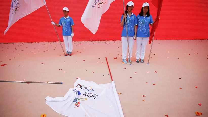 Olympische Winterspiele 2022: Die Olympischen Spiele 2022 werden in Peking ausgetragen – die freiwilligen Helfer freut es.