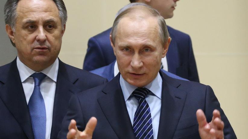 Der russische Präsident Wladimir Putin (rechts) und sein früherer Sportminister Witaly Mutko.