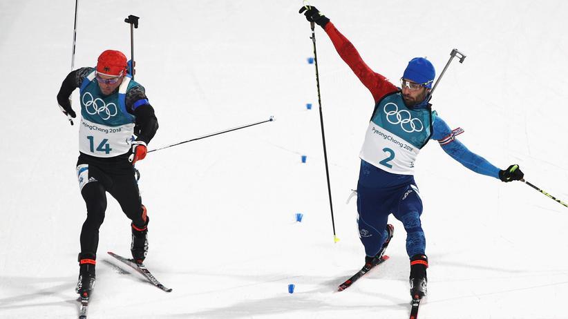 Olympische Winterspiele: Fotofinish zwischen Martin Fourcarde und Simon Schempp.