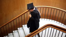 BIRMINGHAM, ENGLAND - JULY 14: A student at the University of Birmingham walks down stairs during the University's degree congregations on July 14, 2009 in Birmingham, England. Over 5000 graduates will be donning their robes this week to collect their degrees from The University of Birmingham. A recent survey suggested that there are 48 graduates competing for every job. (Photo by Christopher Furlong/Getty Images)
