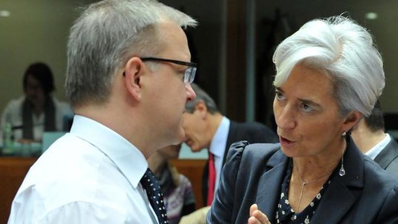 EU-Währungskommissar Olli Rehn (links) und die französische Finanzministerin Christine Lagarde während eines Treffens in Brüssel