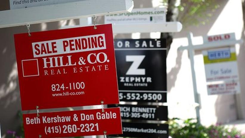 Viele Häuser in den USA stehen noch zum Verkauf: Die Wirtschaft ist noch lange nicht über dem Berg.