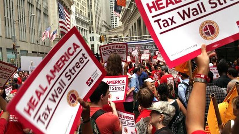 Kapitalismus: Arbeiter demonstrieren an der Wall Street gegen die Finanzwirtschaft und soziale Ungleichheit im Land.