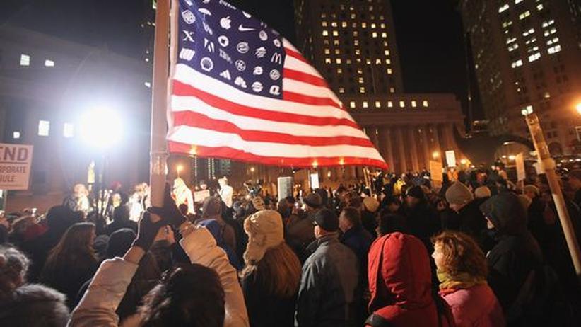 Kapitalismus: New York im Januar 2012: Demonstranten der Occupy-Bewegung protestieren gegen die Macht der Wall Street.