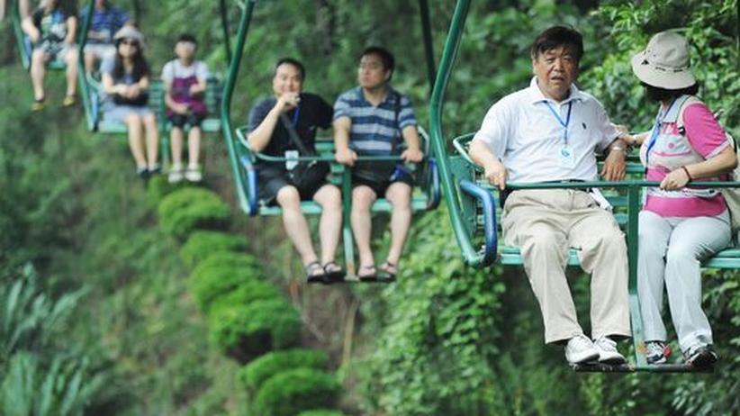 Schwellenländer: Chinesische Touristen während eines Ausflugs entlang des Yangtse-Flusses