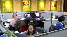 Mitarbeiter der chinesischen Rating-Agentur Dagong in Peking