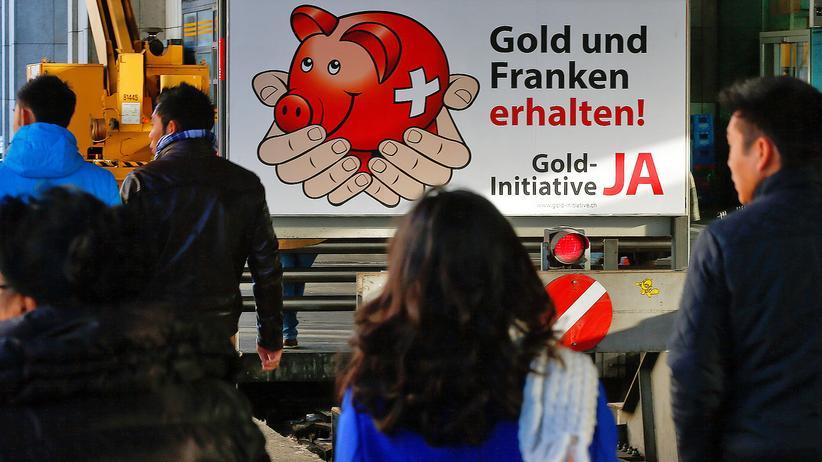 """Ein Plakat der Initiative """"Rettet unser Schweizer Gold"""""""