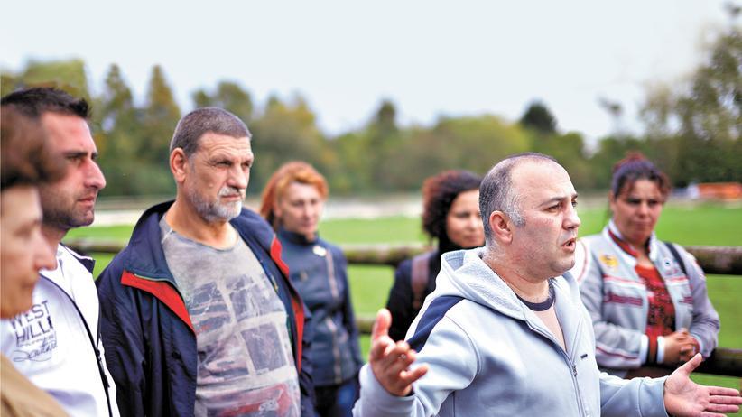 Arbeiter aus Osteuropa, die in deutschen Fleischfabriken arbeiten