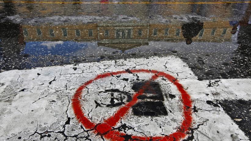 Ein Graffiti zeigt den ehemaligen Ministerpräsidenten Giorgos Papandreou