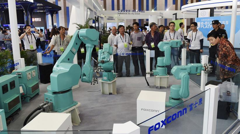 Foxconn: Foxconn präsentiert seine Roboter auf der Expo in Guiyang. (Archiv)