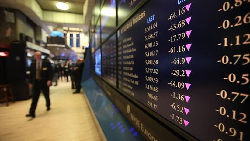 Nach dem Beben: Fallende Kurse am frühen Montagmorgen an der New Yorker Börse. Es war der Beginn des ersten Handelstages nach dem Beben.