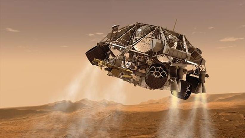 """Weltraum: Die Illustration zeigt den Rover """"Curiosity"""" wenige Minuten vor der Landung auf dem Mars."""