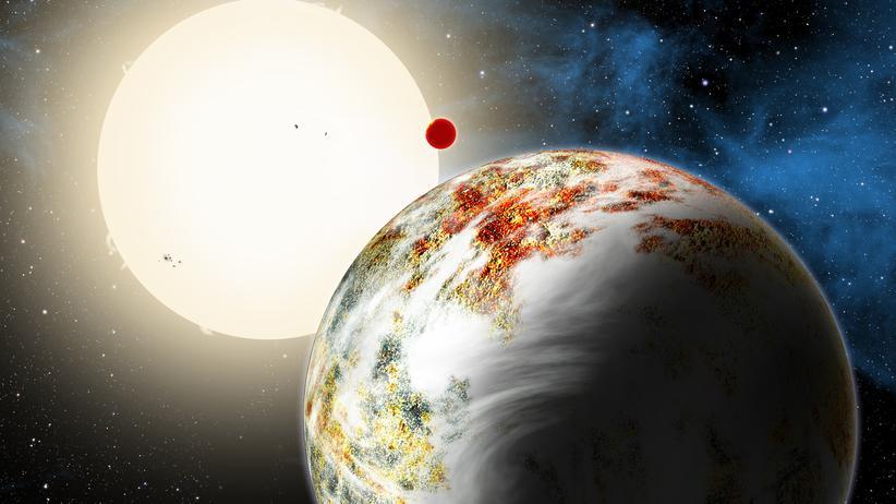 """Neuer Planetentyp: Im Vordergrund der Illustration ist die neu entdeckte """"Mega-Erde"""" Kepler-10c zu sehen, dahinter leuchtet die Lava-Welt Kepler-10b."""