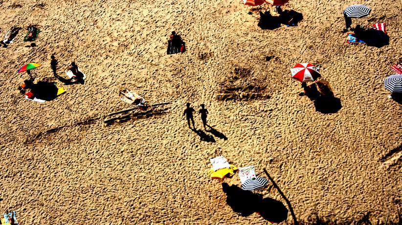 Psychologie: Revierverhalten unterm Sonnenschirm