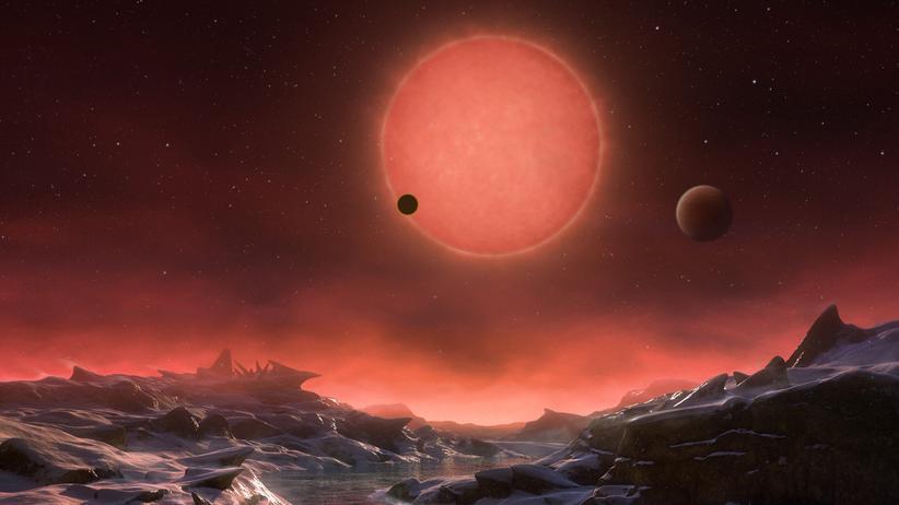 Aliens: Viel Fantasie: So könnte der Blick von einem der Exoplaneten rund um Stern Trappist-1 aussehen. In Wahrheit wissen Forscher weder, ob es dort Wasser oder eine Atmosphäre gibt. Aber zumindest wäre es möglich.