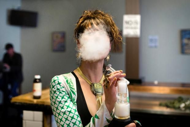 CBD: Elise McRoberts exhales after using a full spectrum oil vaporizer at the new Magnolia cannabis vape lounge in Oakland, California, U.S. April 20, 2018. Friday marked the first '4/20' since the sale of recreational marijuana became legal on January 1. REUTERS/Elijah Nouvelage     TPX IMAGES OF THE DAY - RC1878C1EE80