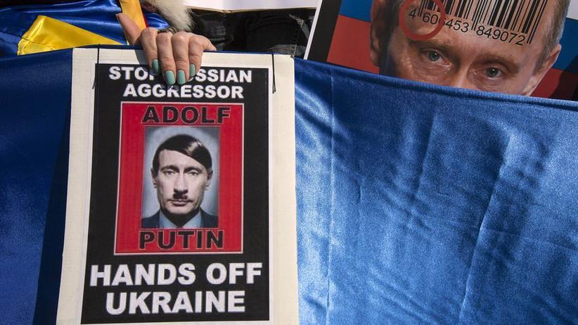 Putin als Hitler bei Protesten den Niederlanden