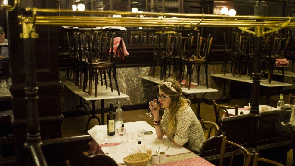 Paris: A client sips a glass of wine during dinner at the French brasserie Chartier, on July 29, 2013 in Paris. AFP PHOTO / FRED DUFOUR (Photo credit should read FRED DUFOUR/AFP/Getty Images)